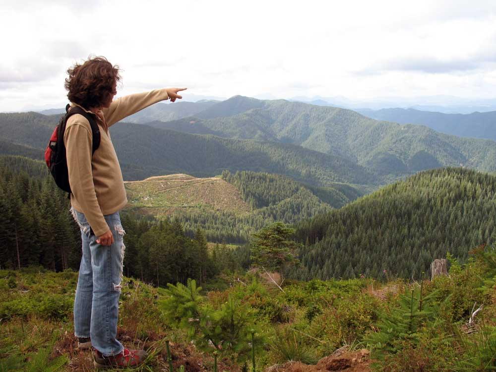 Diana pointing to Nehalem Bay.